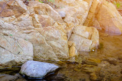 Big brown stone near River nature background Royalty Free Stock Image