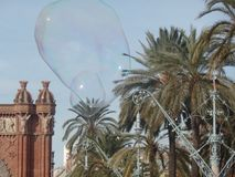 Big bubbles in the Barcelona sky by the Arc de Triomf stock image