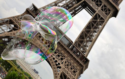 Big bubbles in front of the Eiffel Tower. Large flying soap bubbles on background Eiffel tower Royalty Free Stock Photos