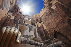 Big buddha against sunbeam at wat Srichum Royalty Free Stock Photo