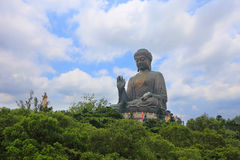 Big Buddha on blue sky in sunshine, Hong Kong. The big Buddha on blue sky in sunshine, Hong Kong royalty free stock image