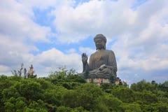 Big Buddha on blue sky in sunshine, Hong Kong Royalty Free Stock Image