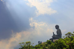 Big Buddha on blue sky in sunshine, Hong Kong. The big Buddha on blue sky in sunshine, Hong Kong stock image