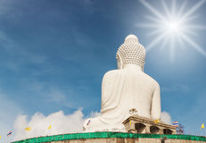 Big buddha in blurred sky and over light the sun Royalty Free Stock Photography