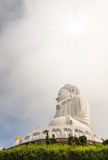 Big buddha in blurred sky and over light the sun Stock Photography