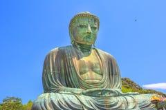 Big Buddha Daibutsu. Big Buddha or Daibutsu on blue sky, one of the largest bronze statue of Buddha Vairocana. Kotoku-in Buddhist Temple in Kamakura from old Royalty Free Stock Photo