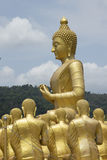 Big Buddha with 1,250 disciple statues. As Macha Bucha Posture, Nakornnayok, Thailand royalty free stock photography