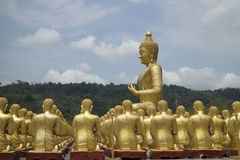 Big Buddha with 1,250 disciple statues. As Macha Bucha Posture, Nakornnayok, Thailand Stock Image