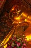 Big Buddha face at Temple of the Reclining Golden Buddha, Bangkok stock images