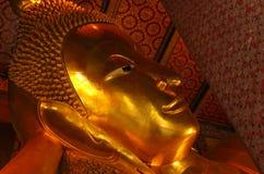 Big Buddha face at Temple of the Reclining Golden Buddha, Grand Palace, Bangkok stock photo