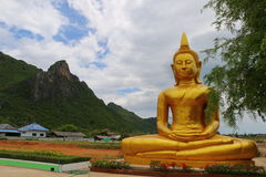 Big Buddha in front of the mountain. Big Buddha sitting in front of the mountain Royalty Free Stock Photo