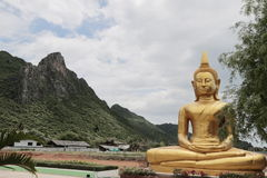 Big Buddha in front of the mountain. Big Buddha sitting in front of the mountain Royalty Free Stock Photography