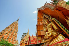 Big Buddha And high pagoda. A place of devotion in Thailand Royalty Free Stock Photo