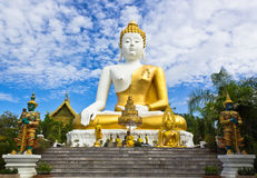 Big Buddha Image. Photo of Big Buddha Statue with the Blue Sky and White Clouds in the Background Royalty Free Stock Photos