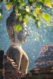 Big buddha image. With green leafs background Sukhothai historical park, Sukhothai, Thailand (taken with reflex lens royalty free stock images