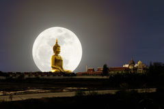 Big Buddha image with supper moon. Big Buddha image at Wat Muang, Ang Thong province, Thailand, with supper full moon in background, multiple exposure technique Stock Image