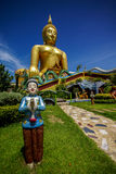 Big Buddha Image with Welcome Boy Statue Royalty Free Stock Images
