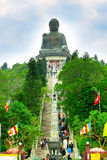 Big Buddha at Lantau island, staircase and people going to statue Royalty Free Stock Photos