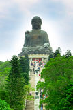 Big Buddha at Lantau island, staircase to statue. Big Buddha, staircase and trees near statue at Lantau Island, Hong Kong Stock Photo