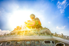 Big Buddha Lantau. Scenic Tian Tan Buddha or Big Buddha, a large bronze statue at Ngong Ping, Lantau Island, Hong Kong, with sunbeams. Concept of spirituality Stock Photo