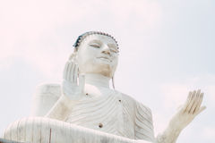 Big Buddha. A large white buddha statue sitting under the sun. 21 Aug 2016 Royalty Free Stock Photos