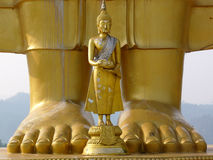 Big Buddha little Buddha. Two Buddha statues at a Thai temple Royalty Free Stock Photos