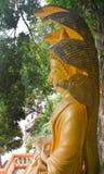 Big Buddha with a naga over His head Stock Photo