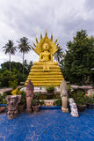 Big  Buddha with a naga over His head in Thai temple Stock Photo