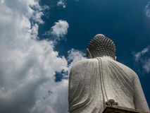 Big Buddha Phuket. Statue of the Big Buddha seen from behind against blue sky with white clouds. In Phuket, Thailand Stock Photos