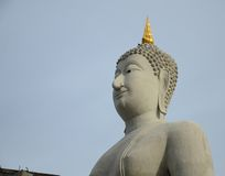 Big buddha statue on blue sky Stock Photography