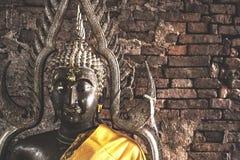 Big buddha statue at Brick wall background. stock images