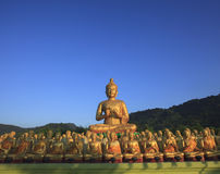 Big buddha statue in buddhist religious temple with beautiful mo. Rning light against clear blue sky use for religion and related topic royalty free stock photos