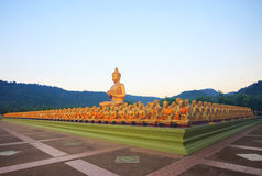 Big buddha statue in buddhist religious temple with beautiful mo Royalty Free Stock Images
