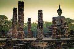 Big buddha statue inside ruin temple at Sukhothai Historical Par Royalty Free Stock Image