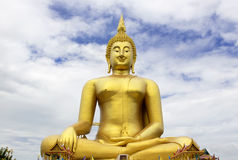 Big buddha statue at Wat muang with blue sky background, Ang-thong Thailand. stock photography