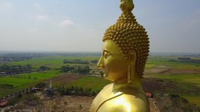 Big Buddha of Thailand, Aerial scene from sky Drone fly down stock footage