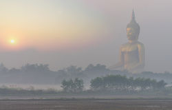 The Big Buddha at Wat Muang Temple with fog Royalty Free Stock Photos