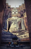 Big buddhist statue. In the old church stock image
