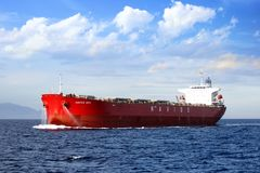 The big bulk-carrier Navios Hope of Navios Company. The big bulk-carrier Navios Hope sailing full ahead in open waters far of the Mediterranean coast of Spain Royalty Free Stock Photography