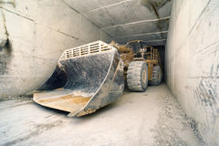 Big bulldozer in marble tunnel, Carrara, Italy Royalty Free Stock Image