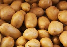 Big bunch of natural potatoes at market Stock Images