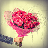 Big bunch of roses in male hand Royalty Free Stock Photography