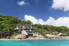Big bungalow in green forest. La Digue isl Stock Photo