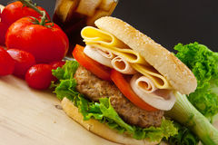 Big Burger. Homemade burger with white onion and tomato Royalty Free Stock Images