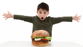 Big Burger. Super huge giant burger and a hungry boy stock photo