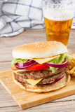 Big burger with beer royalty free stock photo