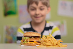 Big burger and chips Royalty Free Stock Photos