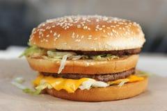Big burger close-up. Isolated on white background royalty free stock photography