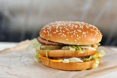 Big burger close-up. On white paper background stock photo