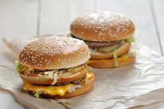 Big burger close-up. On white paper background stock images